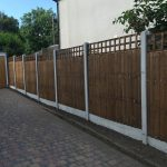 A long wooden fence. The fence has v type close board fence panels.