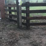 Pressure treated timber rail fence.