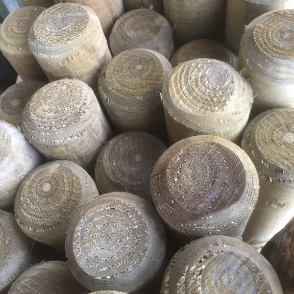 A collection of full round fence posts available for purchase at a fencing suppliers in Birmingham.