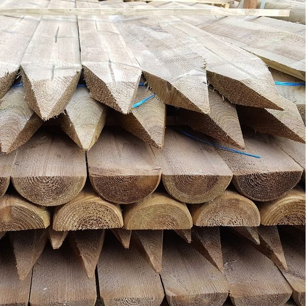 A collection of half round fence posts.