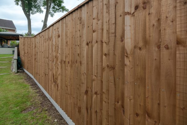 A wooden fence in Birmingham. The fence had feather edge boards.