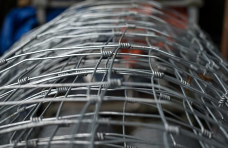 A roll of stock wire that can be used for commercial fencing purposes.