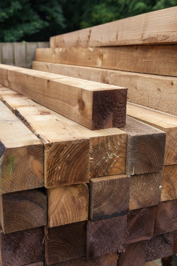 Pressure treated timber. The wood is light in colour and is on display on a fencing suppliers in Birmingham.