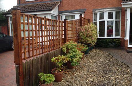 Wooden fencing. The fence has t type timber trellis panels.