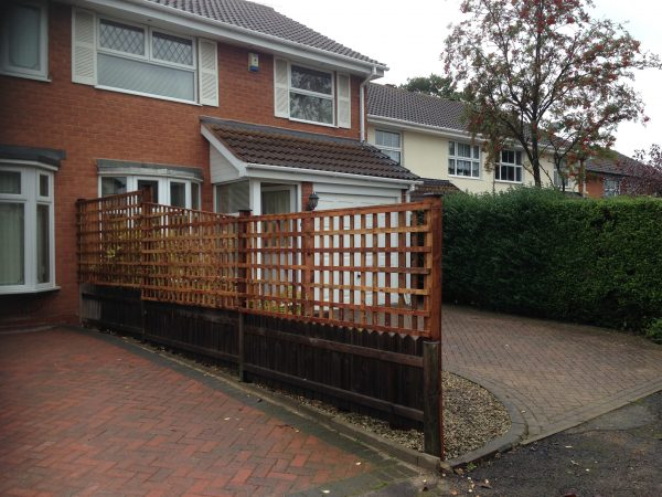 Wooden fence outside of a house in Birmingham. The fence has t type timber trellis fencing panels.