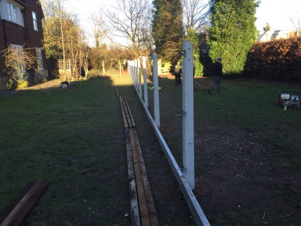Hodges & Lawrence staff erecting concrete fence posts.