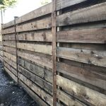 Pressure treated timber rails on display in a fencing suppliers in Birmingham.