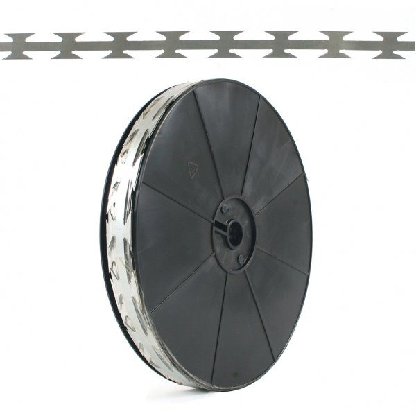 A roll of barbed tape. The barbed tape can provide security. The tape can be added to fences, walls and gates.