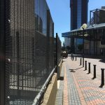 Black steel commercial fencing surrounding an area in Birmingham city centre.