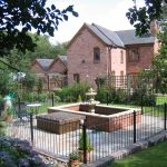 Black bespoke railings used in a garden in Birmingham.