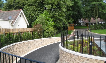 A driveway in Birmingham with bespoke railings on either side.