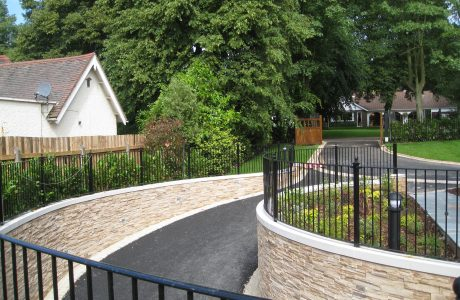 A driveway in Birmingham with bespoke commercial fencing on either side.