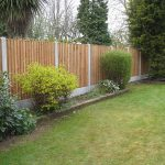 Wooden garden fencing on display at a fencing suppliers in Birmingham.